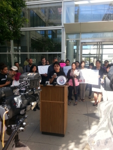 Denisse Rojas, a Greenlining alum and co-Founder of Pre-Health Dreamers, speaks at the October 8 Health4All rally.