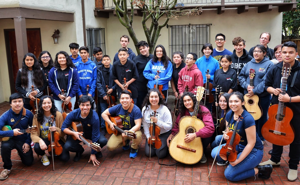 Mariachi Luz de Oro with Mariachi Puente in the Casa courtyard. Lauren Sermeño is the front row, far right.