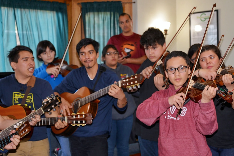 Members of Mariachi Luz de Oro playing alongside Mariachi Puente at Casa Joaquin.