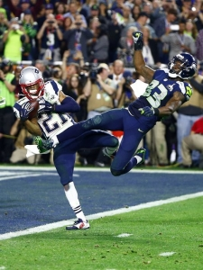 New England defensive back Malcolm Butler intercepts the ball, clinching the victory for the Patriots.