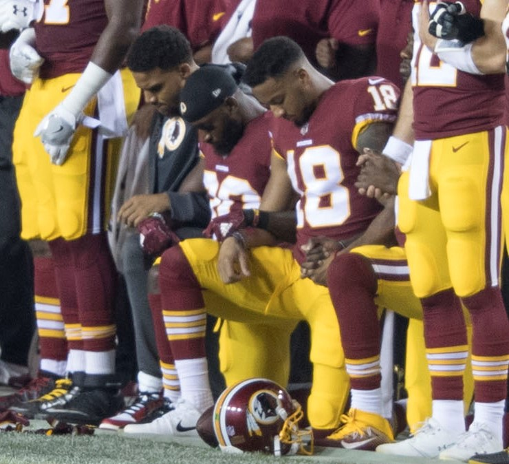 Players kneel for racial justice