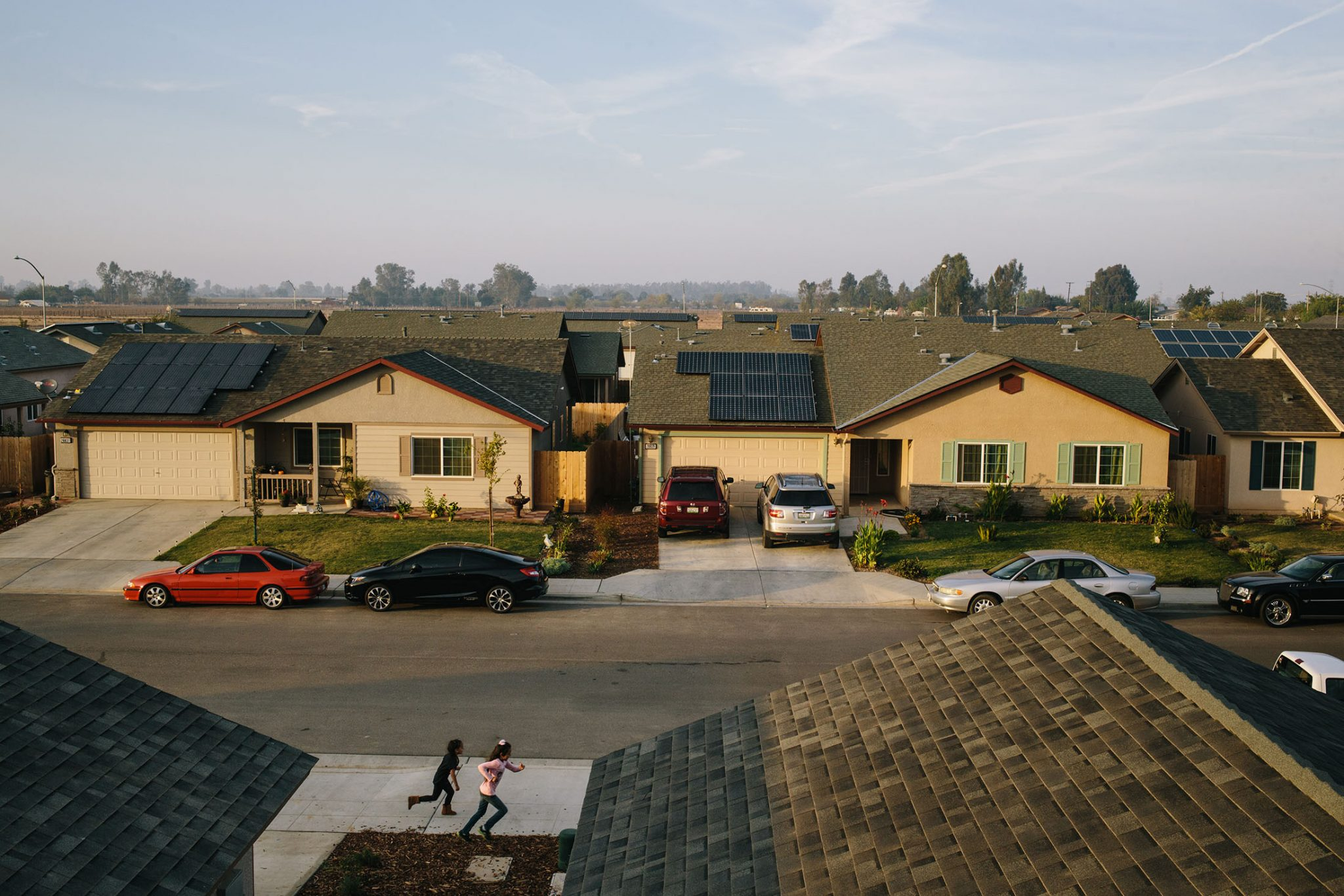 Children play in their neighborhood in Madera, California where Grid Alternatives has retrofitted many of the houses with solar panels.