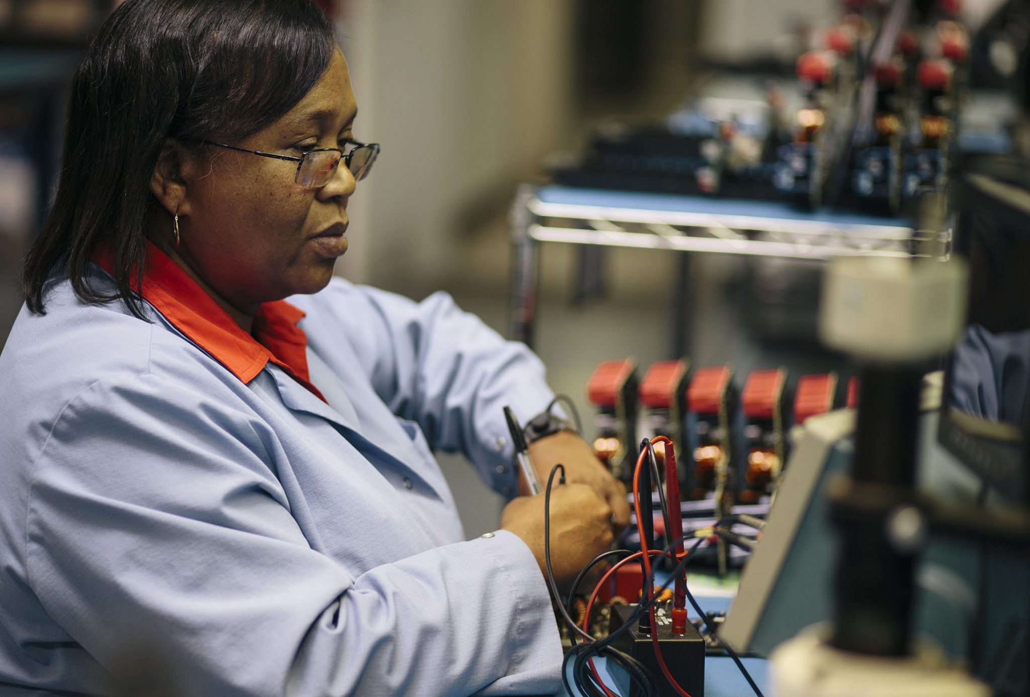 Connie Stewart, 54, runs tests on the circuit board she is assembling in the lab at US Hybrid, an advanced vehicle powertrain supplier in Torrance, California.