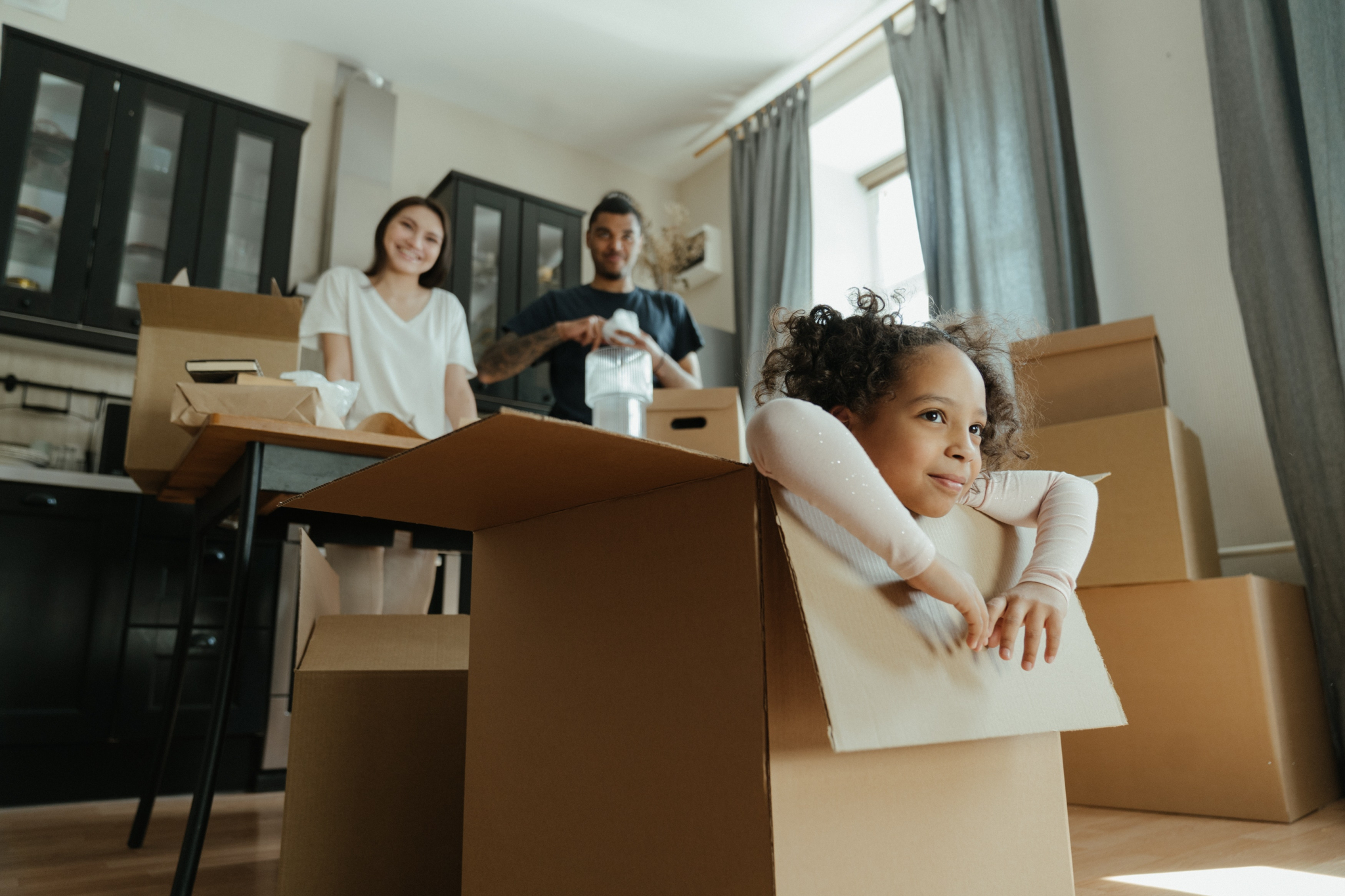 Multiracial family moving in